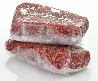 9462960-frozen-ground-meat-in-plastic-package-close-up